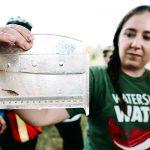 Meghan Rooney measuring fish
