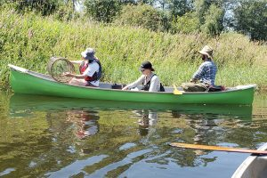 Volunteers and Roxanna in our new canoe on Deboville Slough, Coquitlam